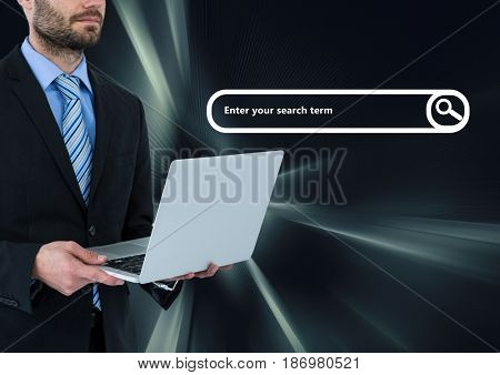 Digital composite of Man on laptop with search bar and dark virtual background