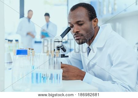 African American Scientist In White Coat Working With Microscope In Laboratory, Laboratory Researche