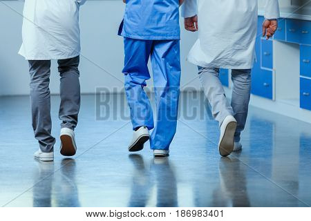 Partial View Of Group Of Doctors Walking In Clinic, Doctor Consultation Concept