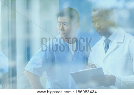Side View Of Doctors Discussing Work, Doctor Conference Concept