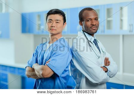 Portrait Of Multiracial Group Of Doctors In Medical Uniforms In Clinic