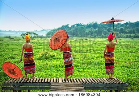 Thai Woman In Traditional Costume With Umbrella (thai Culture Style)