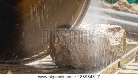 Man Cutting A Stone With A Water Saw