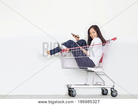 Asian Lady Shopping Cart
