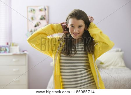 Smiling mixed race girl in bedroom