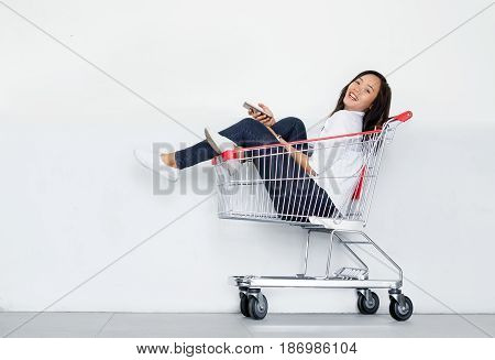 Asian Girl Use Mobile Phone In Cart