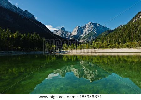 Morning reflections of slovenian Alps on a calm surface of a lake Jasna at Kranjska Gora, Slovenia