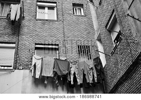 Worker neighborhood building facade with clothes lying
