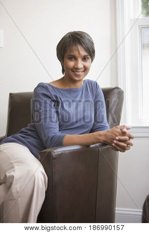 Smiling Native American woman sitting in chair