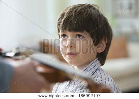 Boy looking at violin