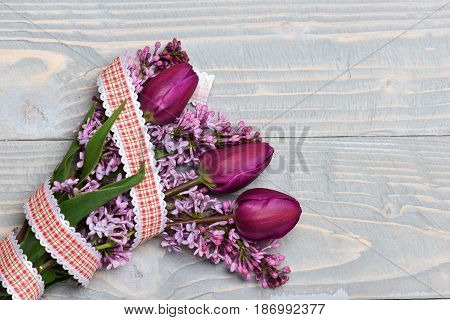 Mothers Day Concept. Lilac Flowers With Tulips On Blue Vintage