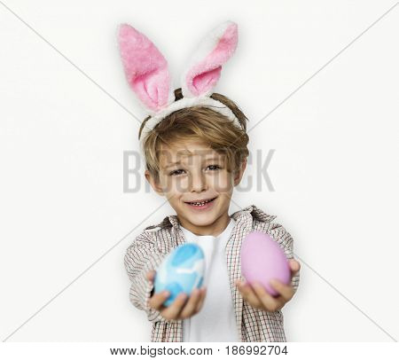 A boy with bunny hairband and easter eggs
