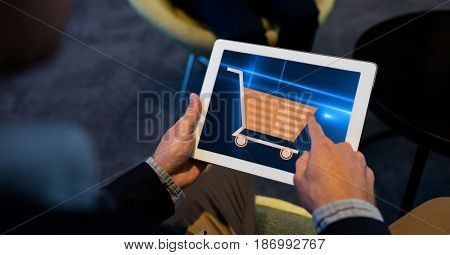 Digital composite of Hand touching shopping cart sign on tablet PC