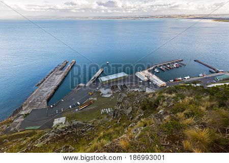Fisherman's Wharf at Stanley Harbor, Bass sea Strait from lookout on the Nut Plateau in Tasmania, Australia. The nut is old volcanic plug of basalt with the height of 143 meters rising from ocean