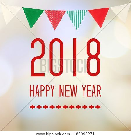 Happy New Year 2018 on abstract blur festive bokeh light and bunting flag background banner