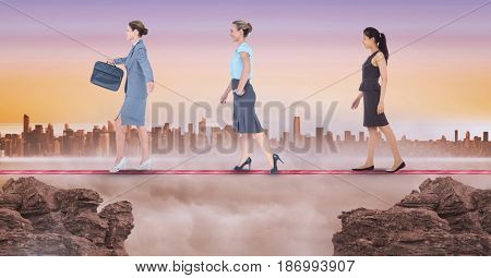 Digital composite of Digital composite image of businesswomen walking on rope during sunset