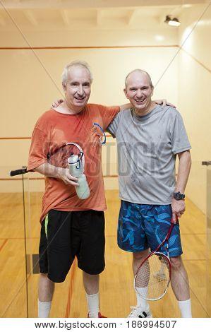 Hispanic men relaxing after racquetball