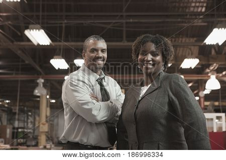 Black business people standing in warehouse