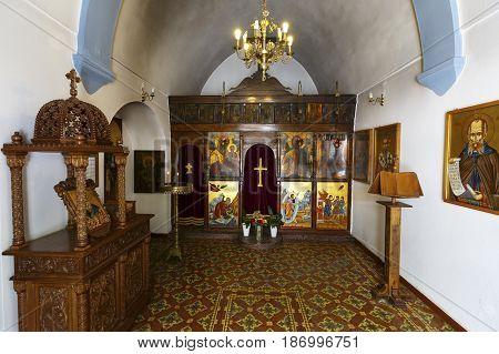 AGIOS NIKOLAOS, GREECE - APRIL 17, 2017:Interior of a Greek orthodox church in the town of Agios Nikolaos in Crete, Greece on April 17, 2017.
