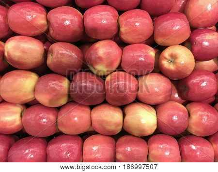 Several Apples in a grocery bin make fresh fruit background