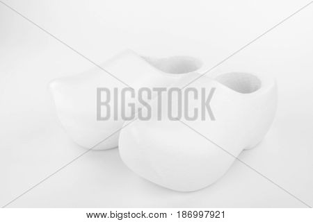 Two traditional Dutch white wooden shoes in a high key recording