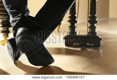 Man feet while playing piano