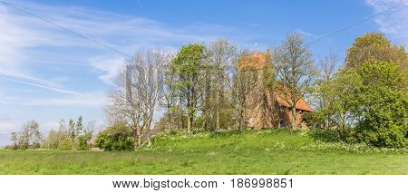 Panorama Of Medieval Church In Historic Village Oostum
