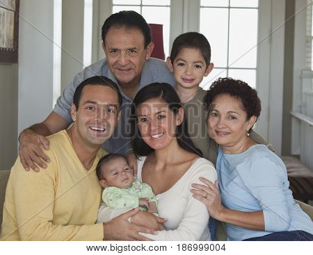Happy family posing with new baby