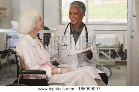 Doctor talking to patient in wheelchair
