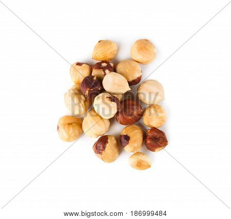 Pile of roasted peeled hazelnuts close-up isolated on white background. Lots of brown nut seeds, healthy vegan and vegetarian food