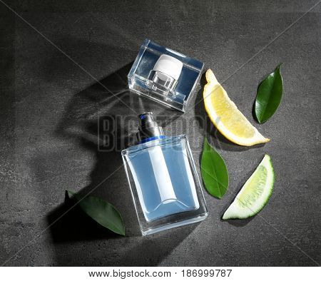 Composition with modern male perfume on grey textured background
