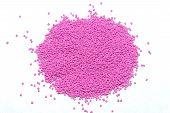The plastic granules. Polymeric pink dye . Dye for plastics in granules . poster