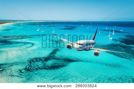 Airplane Is Flying Over Islands And Sea At Sunrise In Summer. Landscape With White Passenger Airplan