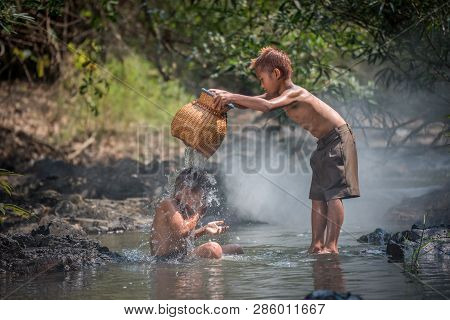 Asia Children On River / The Boy Friend Happy Funny Playing In The Water Stream In Countryside Of Li