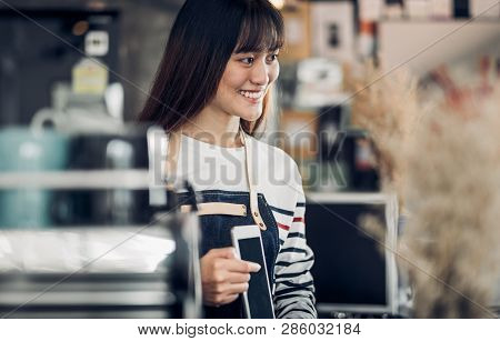 Asia Barista Waiter Use Tablet Take Order From Customer In Coffee Shop,cafe Owner At Counter Bar,foo