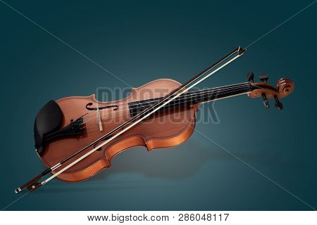 Violin Musical Instruments Of Orchestra Closeup On Blue