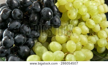 Green And Blue Bunch Of Grapes Lying On A Platter. 4k Uhd 3840x2160 Video Clip