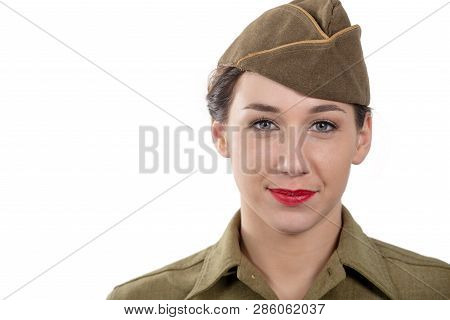 A Pretty Young Woman In Wwii Uniform Us With Garrison Cap On White Background