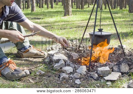 Pot Over The Fire In The Forest. Cooking On A Fire. Spring Camping Concept. Opening Of The New Touri