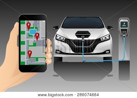 Hand With Mobile Phone On The Background Of A Charging Electric Car. On The Screen Is A Map With The