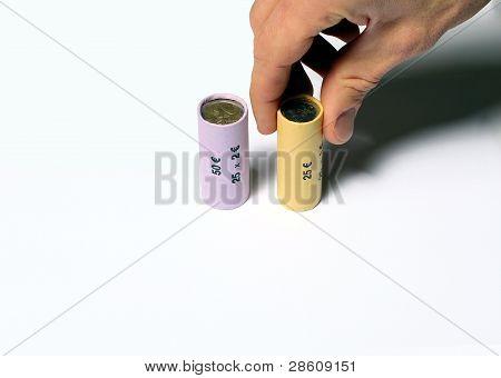 Hand Grabbing A Euro Coin Roll