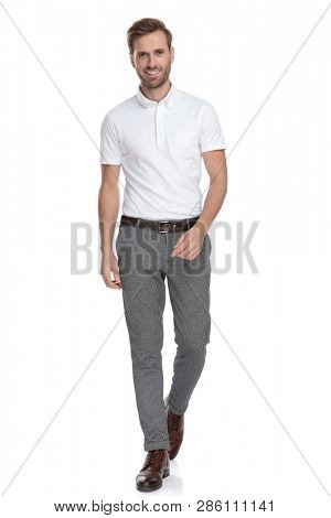 fb8645bf62b confident young casual man is walking forward on white background
