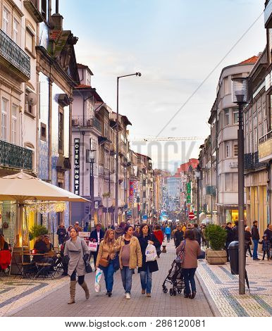 Porto, Portugal - November 26, 2016: Toruists Walking On Santa Catarina Street. Santa Catarina Is A
