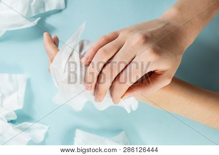 Unreasonable Plastic Pollution Concept: Excessive Use Of Wet Wipes. Close-up View  Hands Getting Cle