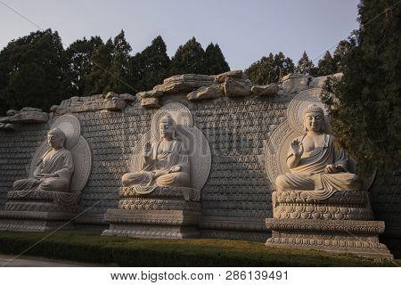 Statues Of The 3 Buddhas On The Thousand Buddha Mountain Autumn Evening, Jinan, China
