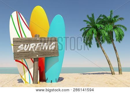 Tourism And Travel Concept. Colorful Summer Surfboards With Surfing Wooden Direction Signbard In Tro