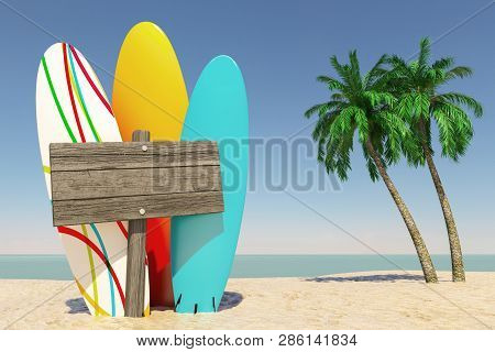 Tourism And Travel Concept. Colorful Summer Surfboards With Blank Wooden Direction Signbard In Tropi