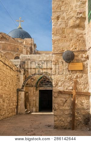 Jerusalem, Israel - November 21, 2018: The 9th station of the cross at Via Dolorosa street at the entrance to the Coptic Orthodox Patriarchate, St. Anthony Coptic Monastery, in Old City of Jerusalem