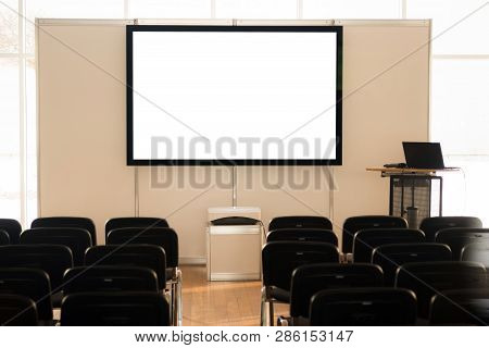 Empty Screen In Conference Room, Meeting Room, Boardroom, Classroom, Office, With White Projector Bo