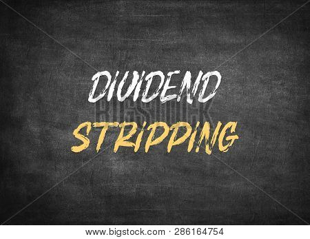 Dividend Stripping on chalkboard background to mean a concept poster
